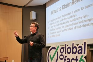 photo of Bill presenting at Global Fact